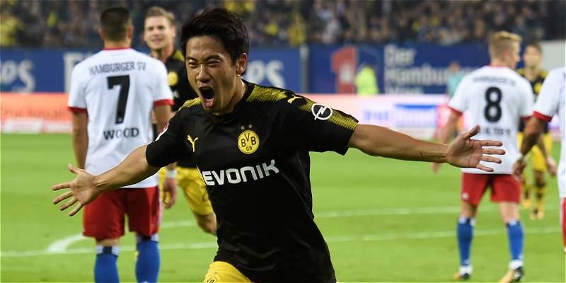 El Dortmund mantiene el liderato tras golear a domicilio al Hamburgo